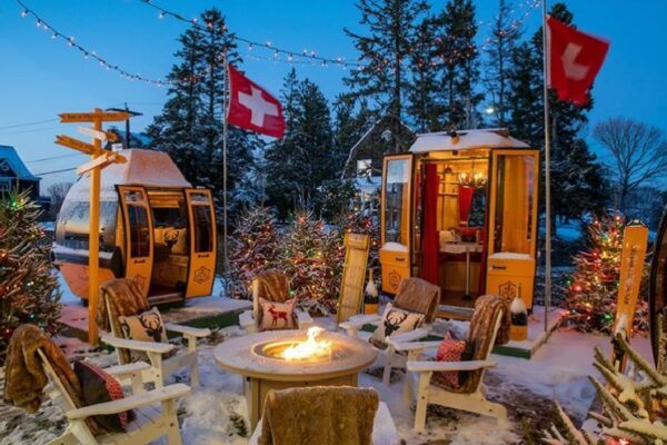 Gondolas converted into dining cabins circling an outdoor firepit